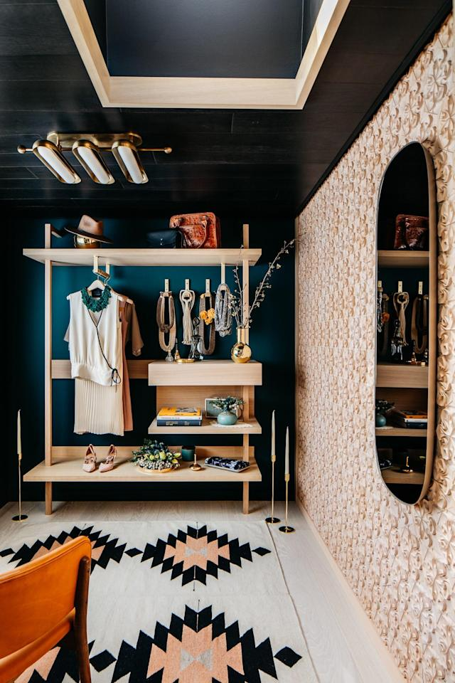 "Inspired by the past and filled with well-curated vintage treasures, this ""Modern Styling Room"" almost turns the closet into an exhibition. The space is simple and clean, making each object within equally precious—including accessories from <a href=""https://www.architecturaldigest.com/story/heath-ceramics-san-francisco-70-years-of-modern-design?mbid=synd_yahoo_rss"" rel=""nofollow noopener"" target=""_blank"" data-ylk=""slk:Heath Ceramics"" class=""link rapid-noclick-resp"">Heath Ceramics</a> and jewelry and scarves from Cecily Chudacoff Couture. A ""Muuto"" mirror from jak-w helps reflect light in the tight retreat."