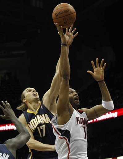 Atlanta Hawks forward Tracy McGrady (1) goes to the basket as Indiana Pacers center Louis Amundson (17) defends in the second half of an NBA basketball game Wednesday, Feb. 8, 2012 in Atlanta. Atlanta won 97-87. (AP Photo/John Bazemore)