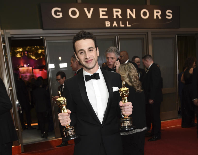 "FILE - In this Feb. 26, 2017, file photo, Justin Hurwitz, winner of the award for best original score for ""La La Land"" and best original song for ""City of Stars"" from ""La La Land,"" attends the Governors Ball after the Oscars at the Dolby Theatre in Los Angeles. Lionsgate announced Monday, March 6, that ""La La Land In Concert: A Live-to-Film Celebration"" will come to the Hollywood Bowl on May 26-27. The live shows will be conducted by Hurwitz. (Photo by Al Powers/Invision/AP, File)"
