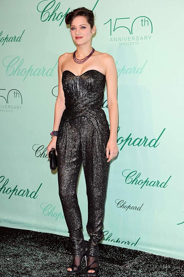 "Oscar winner Marion Cotillard walked away with the title of edgiest ensemble of the night in her Lefranc Ferrant jumpsuit accented with Jimmy Choo shoes. Venturelli/<a href=""http://www.wireimage.com"" target=""new"">WireImage.com</a> - May 17, 2010"