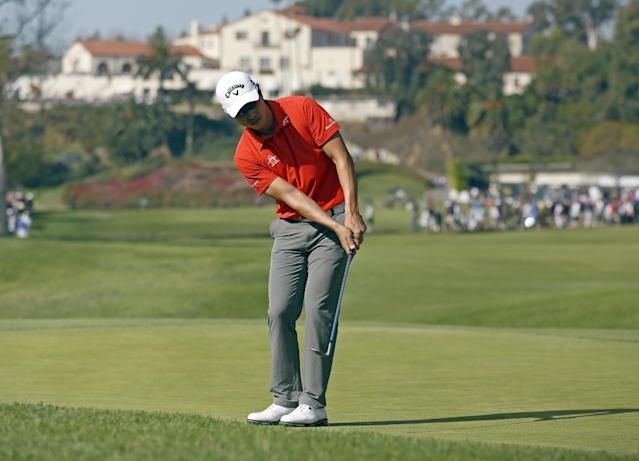 Sang-Moon Bae, of South Korea, chips to the first green at the final round of the Northern Trust Open golf tournament at Riviera Country Club in the Pacific Palisades area of Los Angeles, Sunday, Feb. 16, 2014. (AP Photo/Reed Saxon)