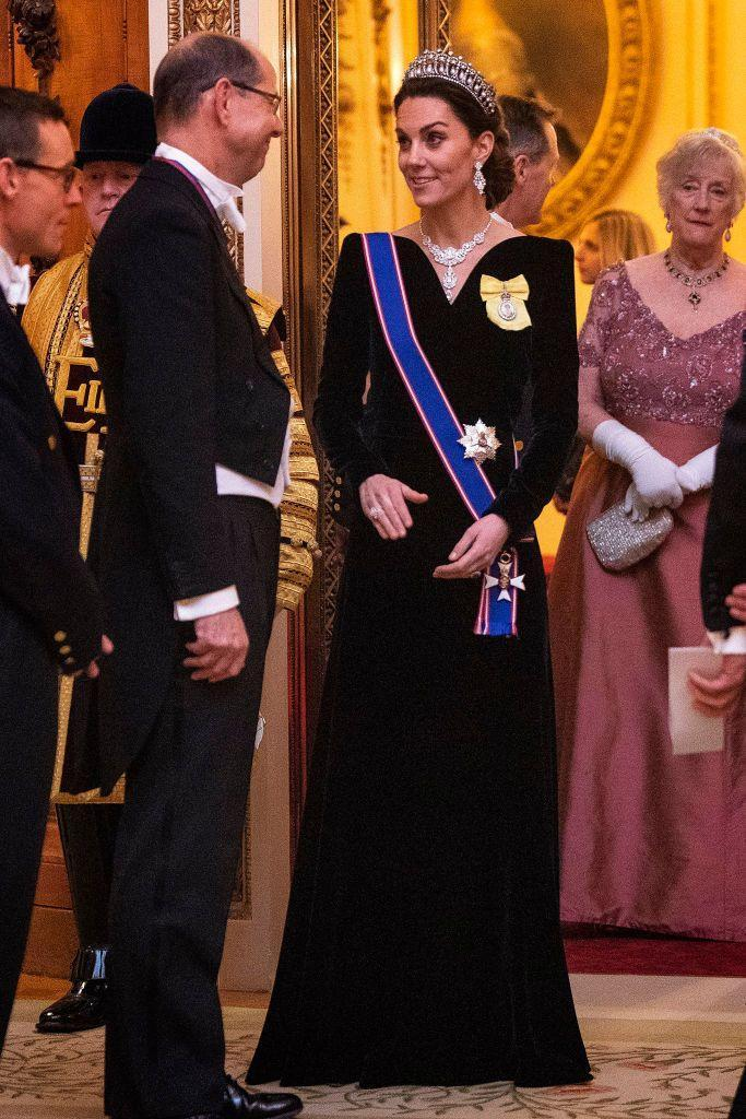 "<p>Kate Middleton pulled out her best formal attire for a diplomatic reception at Buckingham Palace. The Duchess wore a <a href=""https://www.townandcountrymag.com/society/tradition/a30170423/kate-middleton-royal-family-order-gvco-sash-diplomatic-reception-2019/"" rel=""nofollow noopener"" target=""_blank"" data-ylk=""slk:blue sash and yellow pin to the event"" class=""link rapid-noclick-resp"">blue sash and yellow pin to the event</a>, which were her newly granted royal orders. The items were bestowed upon her by the Queen when she was granted the Dame Grand Cross of the Royal Victorian Order.</p>"