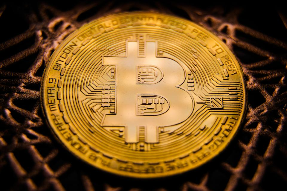 Representation of the Bitcoin cryptocurrency is seen in this illustration photo taken in Poland on November 29, 2020. (Photo illustration by Jakub Porzycki/NurPhoto via Getty Images)