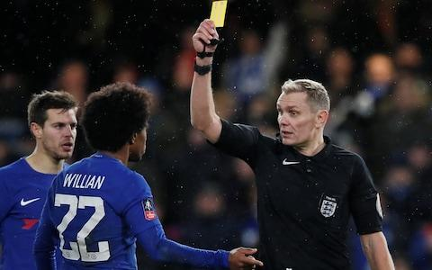 Willian is shown a yellow card for simulation by referee Graham Scott - Credit: Reuters