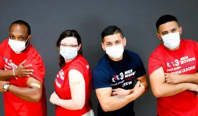 Employees at 3 Men Movers show their adhesive bandages.