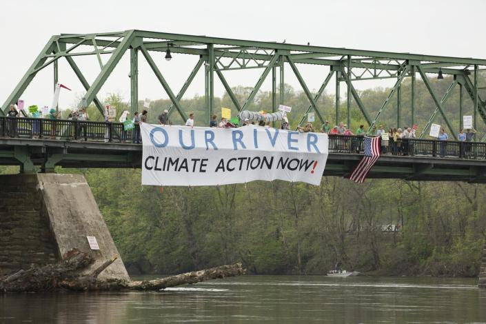 Nearly 100 residents of Bucks County, Pa., and Hunterdon County, N.J., marched across the Uhlerstown–Frenchtown Bridge on April 29, 2017, to protest the Trump administration's environmental policies and the proposed PennEast pipeline. (Photo: Paul Warchol)