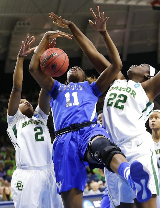 Kentucky forward DeNesha Stallworth (11) battles for a rebound with Baylor guard Niya Johnson (2) and Sune Agbuke (22) during the first half of a regional semifinal in the NCAA college basketball tournament at the Purcell Pavilion in South Bend, Ind., Saturday, March 29, 2014. (AP Photo/Paul Sancya)