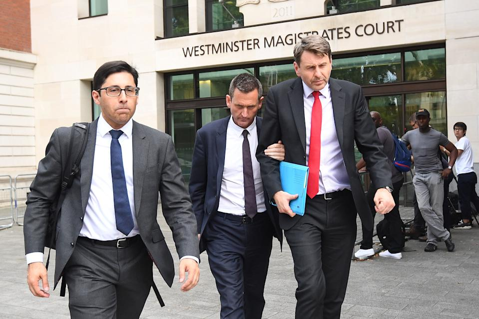 Lord Holmes of Richmond (centre) leaves Westminster Magistrates' Court, London where he appeared on charges of sexual assault.