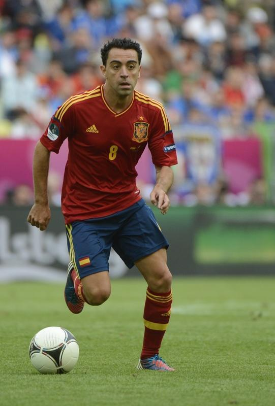 Spanish midfielder Xavi Hernandez controls the ball during the Euro 2012 championships football match Spain vs Italy on June 10, 2012 at the Gdansk Arena. AFP PHOTO / PIERRE-PHILIPPE MARCOUPIERRE-PHILIPPE MARCOU/AFP/GettyImages