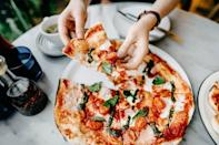 """<p>OK, it's true: The greasy dollar-slice pizza down the block is not even close to the picture of health. But all pizza is not created equal, friends. """"Pizza can be loaded with fat and calories, but it doesn't have to be!"""" Donna Rose, registered dietitian of <a href=""""http://www.nonasnutritionnotes.com/"""" rel=""""nofollow noopener"""" target=""""_blank"""" data-ylk=""""slk:Nona's Nutrition Notes"""" class=""""link rapid-noclick-resp"""">Nona's Nutrition Notes</a>, tells Delish. How can you make it a better option? Rose says to make your own pizza with a thin crust, topped with lots of veggies, tomatoes, and low-fat cheese. """"Tomatoes provide Vitamins A and C, as well as potassium, phosphorous, folic acid, beta-carotene, and a host of other beneficial nutrients."""" </p>"""