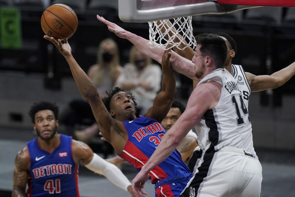 Detroit Pistons guard Saben Lee (38) shoots against San Antonio Spurs forward Drew Eubanks (14) during the second half of an NBA basketball game in San Antonio, Thursday, April 22, 2021. (AP Photo/Eric Gay)