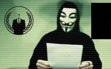 54944905_A-man-wearing-a-mask-associated-with-Anonymous-makes-a-statemen--2-
