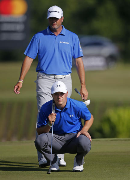 Ryan Palmer, standing, lines up a shot with teammate Jordan Spieth on the 18th green, during the first round of the PGA Zurich Classic golf tournament's new two-man team format at TPC Louisiana in Avondale, La., Thursday, April 27, 2017. They birdied the hole to end the day tied for first at 6 under par. (AP Photo/Gerald Herbert)