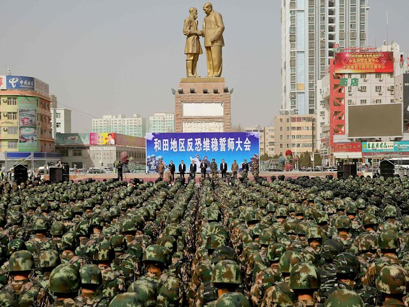 Chinese military police attending an anti-terrorist oath-taking rally in northwest China's Xinjiang province: Getty