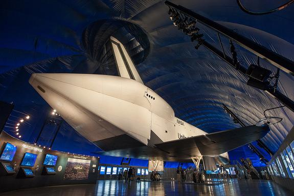 NASA's space shuttle Enterprise, the space agency's original prototype for its winged orbiter fleet, opens on display at the Intrepid Sea, Air and Space Museum in New York City on July 19, 2012. <a href=http://www.collectspace.com/news/news-071