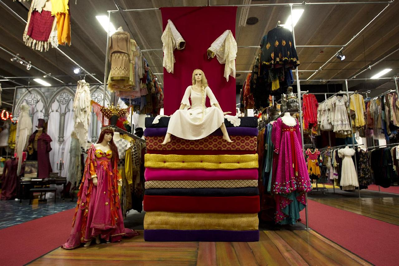 """This Oct, 3, 2012 photo shows one of the sets from the play, """"Once Upon A Mattress"""", at the costume museum in Pompano Beach, Fla. Marilynn Wick and her daughter Kimberly opened a museum in 2011, showcasing more than one million costumes from nearly 50 shows, guiding daily tours through a non-de script South Florida warehouse against a backdrop of hand painted sets and a marquee replica from storied Broadway theaters like the Winter Garden. (AP Photo/J Pat Carter)"""
