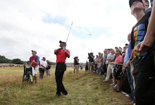 Tiger Woods plays a shot along the 12th fairway during the final round of the British Open. (AP)