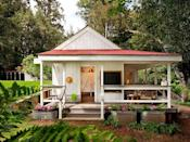 """<p>Though it clocks in at just 260-square-feet, this cottage's bright and colorful design exudes a cheery atmosphere from all corners. Designed by <a href=""""http://www.richardsonarchitects.com/"""" rel=""""nofollow noopener"""" target=""""_blank"""" data-ylk=""""slk:Richardson Architects"""" class=""""link rapid-noclick-resp"""">Richardson Architects</a>, the tiny structure is situated on a dairy farm near the Northern California coastline and was constructed using non-corrosive and wear-resistant materials. The exterior features a large wraparound porch, a chalkboard, and ample seating, while the interior is filled with bright red and yellow hues. </p><p><a class=""""link rapid-noclick-resp"""" href=""""https://www.countryliving.com/home-design/house-tours/a6383/richardson-architects-tiny-house/"""" rel=""""nofollow noopener"""" target=""""_blank"""" data-ylk=""""slk:SEE INSIDE"""">SEE INSIDE</a></p>"""