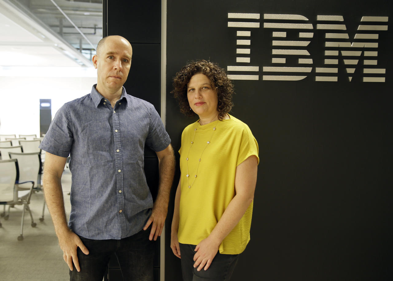 Dr. Noam Slonim, left, principal investigator and Dr. Ranit Aharonov, right, manager, pose near the IBM Project Debater before a debate between the computer and two human debaters Monday, June 18, 2018, in San Francisco. IBM on Monday will pit a computer against two human debaters in the first public demonstration of artificial intelligence technology it's been working on for more than five years. The system, called Project Debater, is designed to be able to listen to an argument, then respond in a natural-sounding way, after pulling in evidence it collects from Wikipedia, journals, newspapers and other sources to make its point. (AP Photo/Eric Risberg)