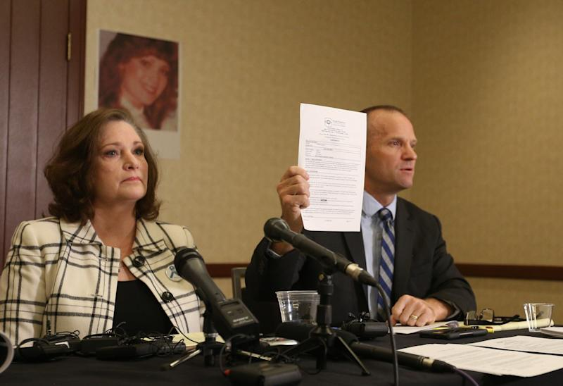 Attorney Craig Vernon holds upthe results of his client McKenna Denson's lie detector test. Denson is suing the Church of Jesus Christ of Latter-day Saints for its handling of her rape allegations. (George Frey/Getty Images)