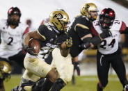 Colorado running back Jarek Broussard, front, runs for a short gain as San Diego State linebacker Segun Olubi pursues during the second half of an NCAA college football game Saturday, Nov. 28, 2020, in Boulder, Colo. (AP Photo/David Zalubowski)