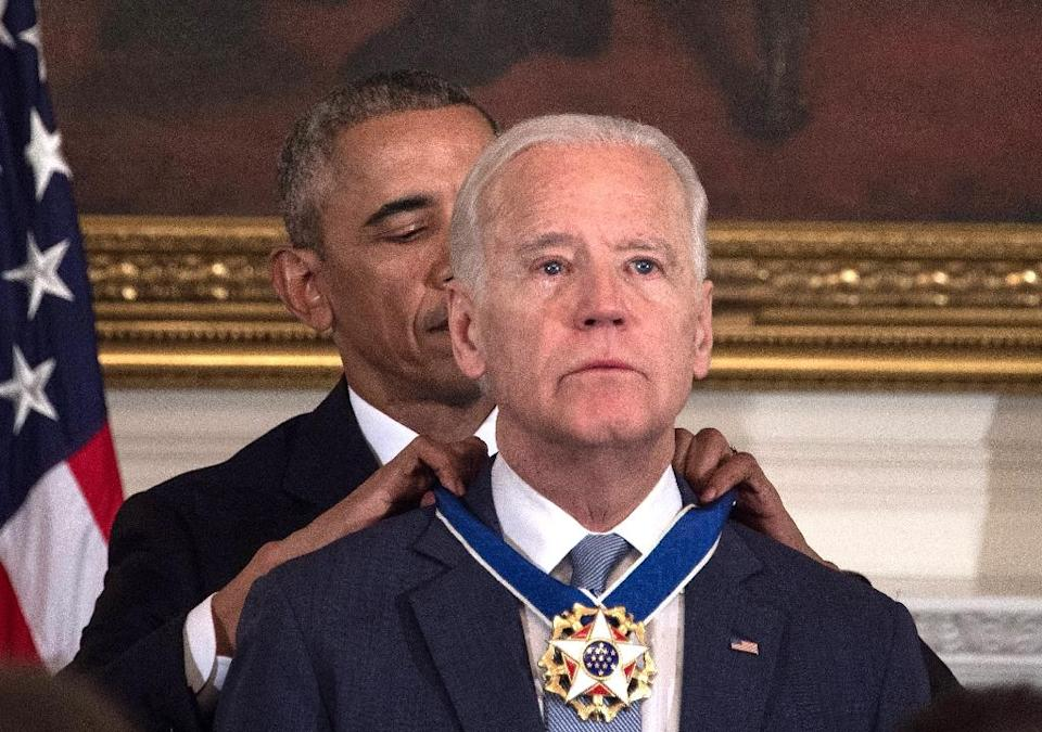 Then-US president Barack Obama awarded vice president Joe Biden the Presidential Medal of Freedom in January 2017, near the end of their eight years in the White House (AFP Photo/NICHOLAS KAMM)