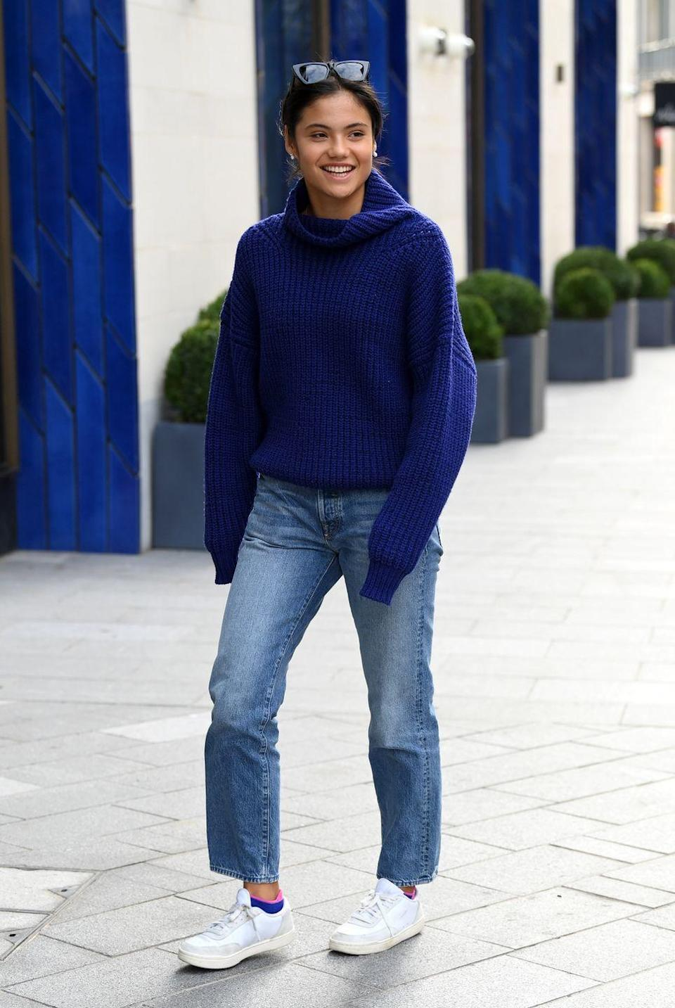<p>Raducanu was spotted walking through London wearing a pair of white trainers, Mom jeans, a roll neck dark electric blue jumper and sunglasses atop her head. </p>