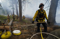 Will Fitch, fire captain from Cosumnes Fire Department, and his crew hold a fire line to keep the Caldor Fire from spreading in South Lake Tahoe, Calif., Friday, Sept. 3, 2021. Fire crews took advantage of decreasing winds to battle a California wildfire near popular Lake Tahoe and were even able to allow some people back to their homes but dry weather and a weekend warming trend meant the battle was far from over.(AP Photo/Jae C. Hong)