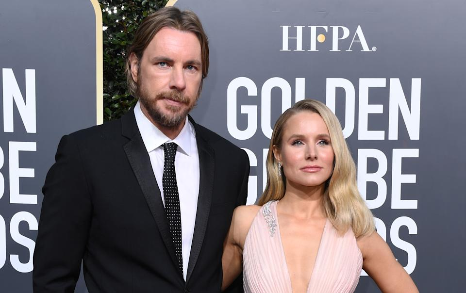"Best Performance by an Actress in a Television Series  Musical or Comedy for ""The Good Place"" nominee Kristen Bell (R) and husband actor Dax Shepard arrive for the 76th annual Golden Globe Awards on January 6, 2019, at the Beverly Hilton hotel in Beverly Hills, California. (Photo by VALERIE MACON / AFP)        (Photo credit should read VALERIE MACON/AFP via Getty Images)"