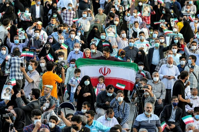 Supporters of Raisi gather during a rally celebrating his victory in Tehran's Imam Hussein square