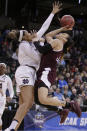 Texas A&M guard Chennedy Carter, right, shoots against Notre Dame forward Kristina Nelson during the first half of a regional semifinal at the NCAA women's college basketball tournament, Saturday, March 24, 2018, Spokane, Wash. (AP Photo/Young Kwak)