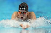 Lilly King participates in the women's 100 breaststroke during wave 2 of the U.S. Olympic Swim Trials on Tuesday, June 15, 2021, in Omaha, Neb. (AP Photo/Charlie Neibergall)