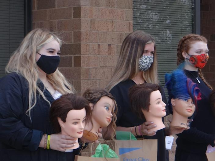 Competitors in the state Skills USA cosmetology finals show off their work to teachers and parents, who had to wait outside the competition because of COVID-19 restrictions. (Patrick O'Donnell)