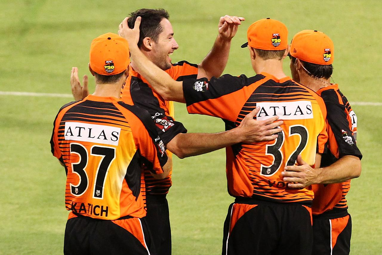 PERTH, AUSTRALIA - DECEMBER 09: Scorchers players celebrate after taking the the wicket of Callum Ferguson of the Strikers  during the Big Bash League match between the Perth Scorchers and Adelaide Strikers at WACA on December 9, 2012 in Perth, Australia.  (Photo by Will Russell/Getty Images)