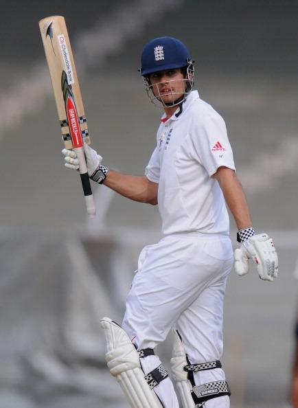 MUMBAI, INDIA - OCTOBER 31:  Alastair Cook captain of England raises his bat towards the dressing room after scoring a century during the second day of the first practice match between England and India 'A' at the CCI (Cricket Club of India) ground, on October 31, 2012 in Mumbai, India.  (Photo by Pal Pillai/Getty Images)