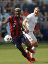 United States forward Gyasi Zardes (9) chases down the ball as Canada midfielder Samuel Piette (6) defends during the first half of a CONCACAF Gold Cup soccer match in Kansas City, Kan., Sunday, July 18, 2021. (AP Photo/Colin E. Braley)