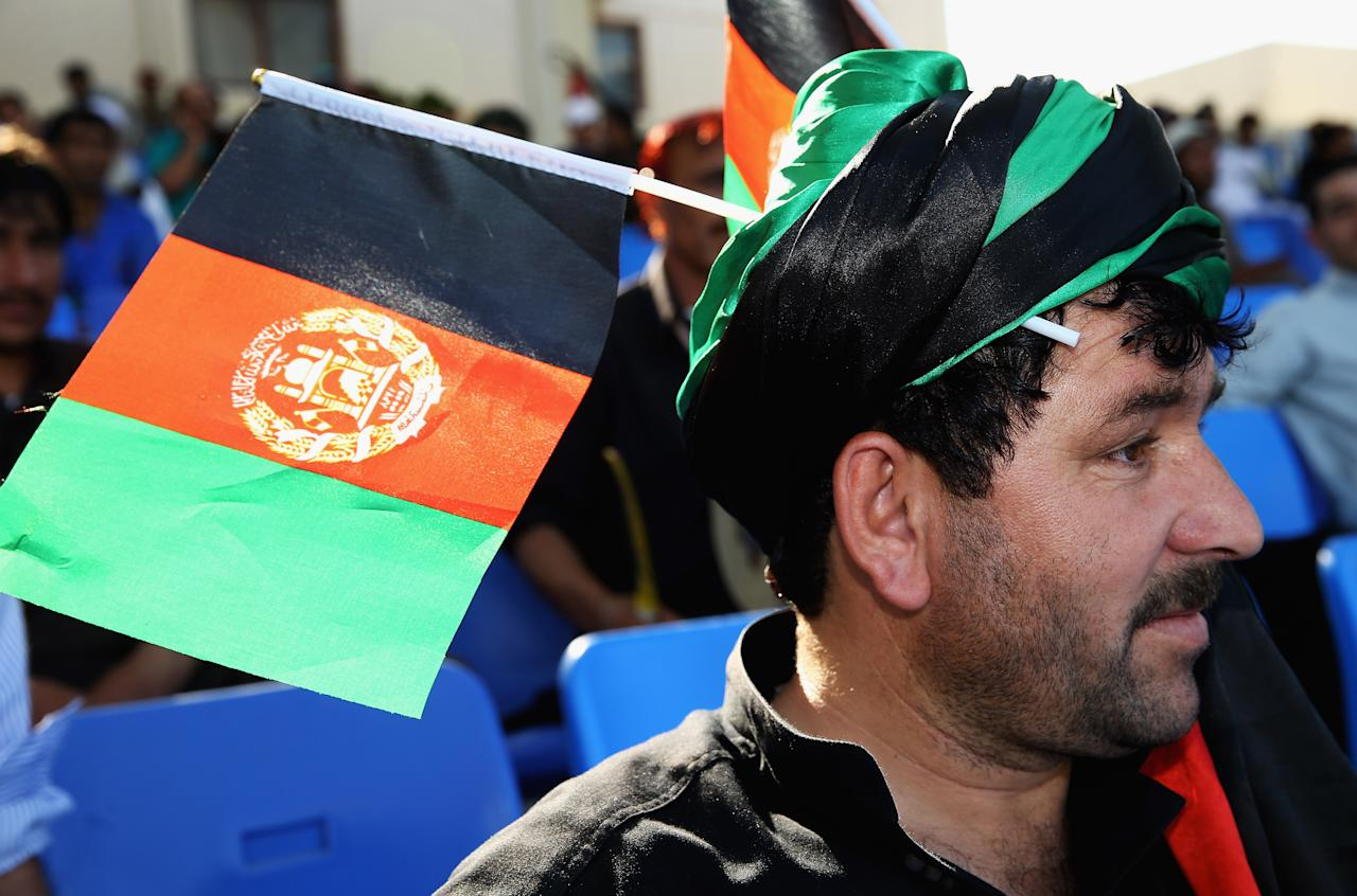 DUBAI, UNITED ARAB EMIRATES - NOVEMBER 24:  An Afghanistan supporter looks on during the ICC World Twenty20 Qualifier between Afghanistan and Kenya at Sharjah Cricket Stadium on November 24, 2013 in Dubai, United Arab Emirates.  (Photo by Matthew Lewis-IDI/IDI via Getty Images)