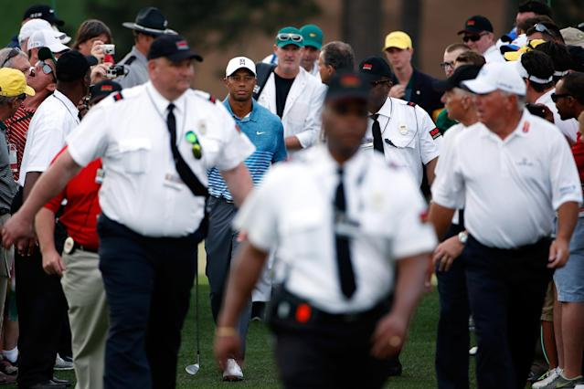 Security walks with Tiger Woods during a practice round at Augusta National in 2015. (Getty)
