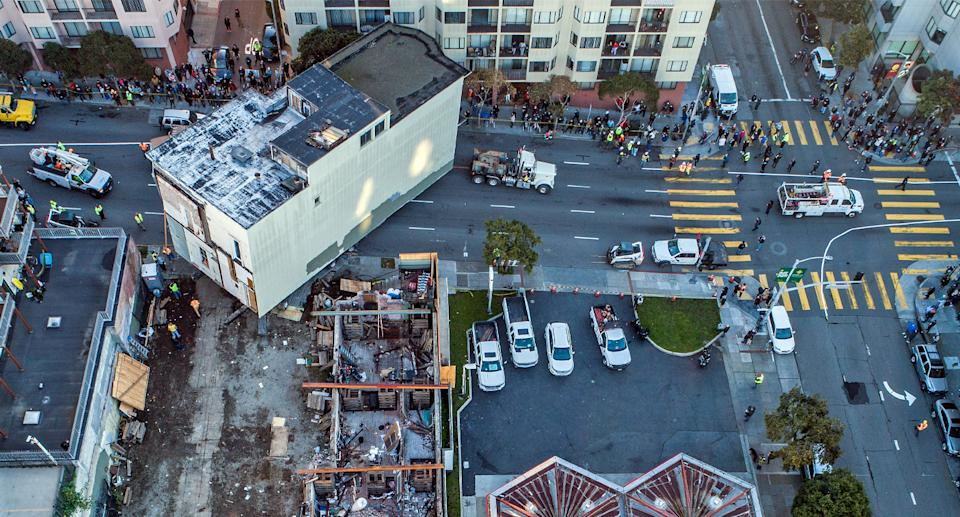 An aerial shot of the Victorian home being moved from its original location in San Francisco.