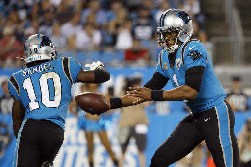 Carolina Panthers quarterback Cam Newton (1) hands off to wide receiver Curtis Samuel (10) during the second half of an NFL football game against the Tampa Bay Buccaneers in Charlotte, N.C., Thursday, Sept. 12, 2019. (AP Photo/Brian Blanco)