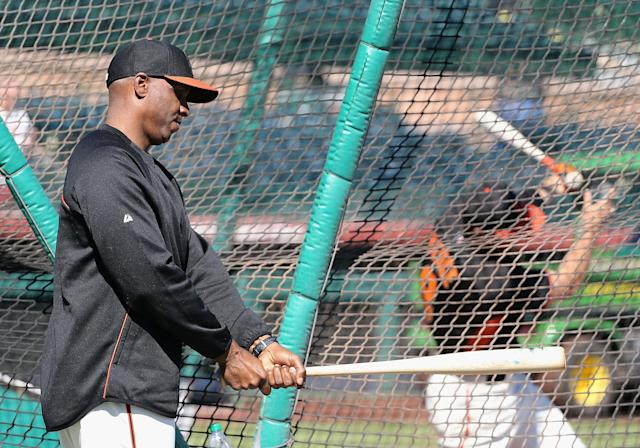 SCOTTSDALE, AZ - MARCH 10: Barry Bonds of the San Francisco Giants who was brought on as a special hitting coach for one week of Spring Training picks up a bat during batting practice at Scottsdale Stadium on March 10, 2014 in Scottsdale, Arizona. (Photo by Christian Petersen/Getty Images)