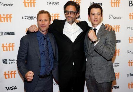 """Director Younger poses with actors Teller  and Eckhart as they arrive on the red carpet for the film """"Bleed for This"""" during the Toronto International Film Festival in Toronto"""