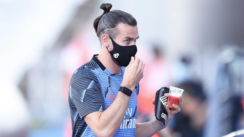 Gareth Bale leaving training with a drink.