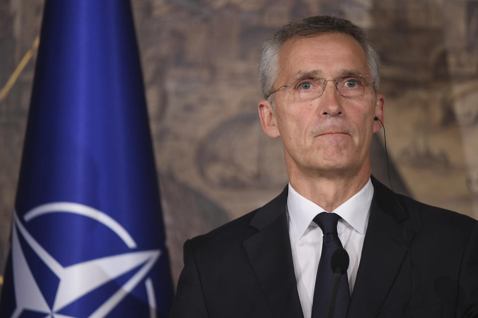 NATO Secretary General Jens Stoltenberg listens during a joint press conference with Turkish Foreign Minister Mevlut Cavusoglu, in Istanbul, Friday, Oct. 11, 2019. NATO's secretary-general says he acknowledges Turkey's legitimate security concerns but has urged Ankara to exercise restraint in its incursion into northeast Syria. (AP Photo/Akin Celiktas)