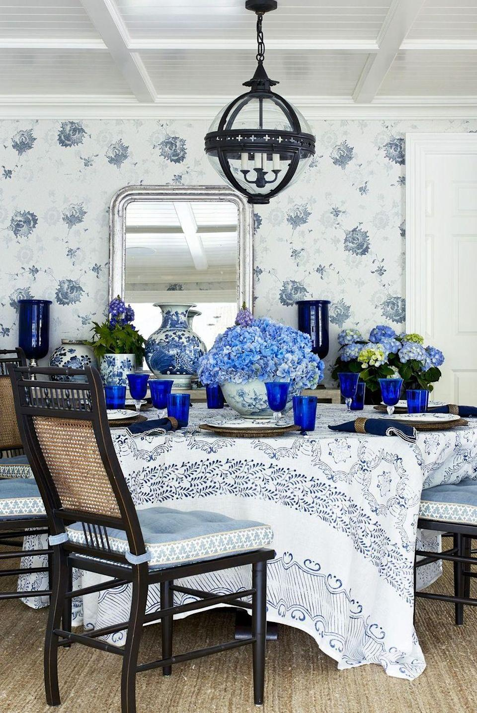 """<p>Designer Lee Ann Thornton created a blue color palette in this <a href=""""https://www.housebeautiful.com/design-inspiration/house-tours/g13120250/lee-ann-thornton-connecticut-ranch/"""" rel=""""nofollow noopener"""" target=""""_blank"""" data-ylk=""""slk:Greenwich, Connecticut ranch"""" class=""""link rapid-noclick-resp"""">Greenwich, Connecticut ranch</a>, starting with the wallpaper, tablecloth, and glasses, and ending with vibrant blue hydrangeas. If you like the idea of going tonal, follow this example on Sunday for your Easter table by gone monochromatic. </p><p><strong><em>Anissa Kermiche Popoton Ceramic Vase, $70 </em></strong><a class=""""link rapid-noclick-resp"""" href=""""https://go.redirectingat.com?id=74968X1596630&url=https%3A%2F%2Fwww.matchesfashion.com%2Fus%2Fproducts%2FAnissa-Kermiche-Popotin-ceramic-vase-1316666&sref=https%3A%2F%2Fwww.housebeautiful.com%2Fentertaining%2Fflower-arrangements%2Fg19409803%2Feaster-flower-arrangements%2F"""" rel=""""nofollow noopener"""" target=""""_blank"""" data-ylk=""""slk:BUY NOW"""">BUY NOW</a></p>"""