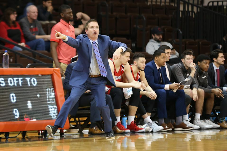 Hartford coach John Gallagher shouts instructions to his players during a game against Bowling Green on Dec. 31, 2019.  (Scott W. Grau/Icon Sportswire via Getty Images)