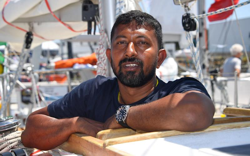 India's skipper Abhilash Tomy poses on his boat