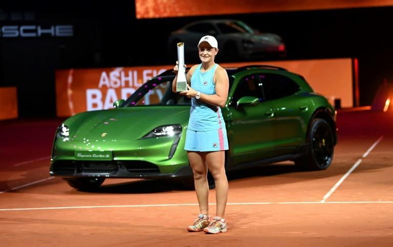 Ashleigh Barty poses with her trophy and prize, a sports car, after winning the final of the WTA tournament in Stuttgart on Sunday