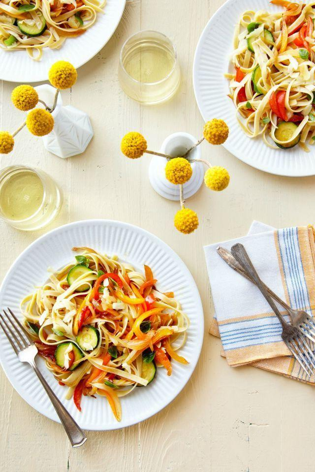 "This refreshing pasta dish gives your favorite spaghetti a springtime twist. <a href=""https://www.countryliving.com/food-drinks/recipes/a38072/pasta-with-sauteed-peppers-zucchini-and-smoked-mozzarella-recipe/"" rel=""nofollow noopener"" target=""_blank"" data-ylk=""slk:Get the recipe."" class=""link rapid-noclick-resp""><strong>Get the recipe.</strong></a><br> <a href=""https://www.amazon.com/Lodge-Cast-Iron-Skillet-15-inch/dp/B00063RWUM/r?tag=syn-yahoo-20&ascsubtag=%5Bartid%7C10050.g.1186%5Bsrc%7Cyahoo-us"" class=""link rapid-noclick-resp"" rel=""nofollow noopener"" target=""_blank"" data-ylk=""slk:SHOP SKILLETS"">SHOP SKILLETS</a>"