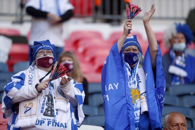 Leicester City fans wearing face coverings